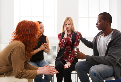 Group of people in a support group setting.