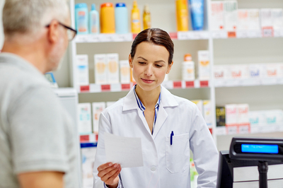 Pharmacist helping a customer.