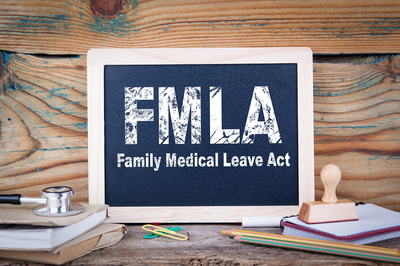 FMLA written on a chalkboard.