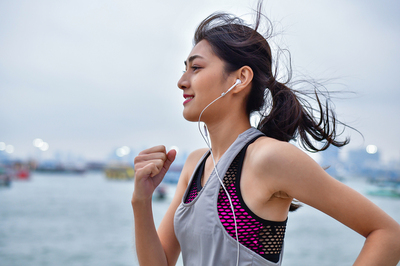 Woman running with headphones.