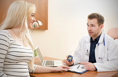 Woman seeking a consult from a medical doctor.