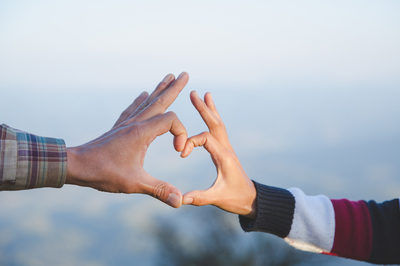 Two hands forming a heart.
