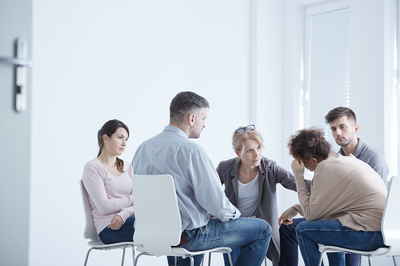 Addiction recovery group meeting in a circle.
