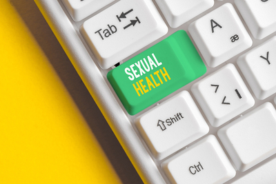 Computer keyboard with a caps lock key labeled sexual health.