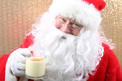 Santa Claus drinking a cup of milk.