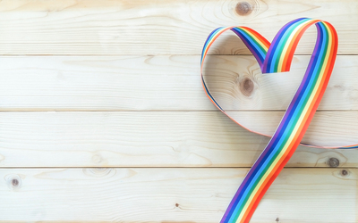 Heart created with a rainbow colored ribbon.