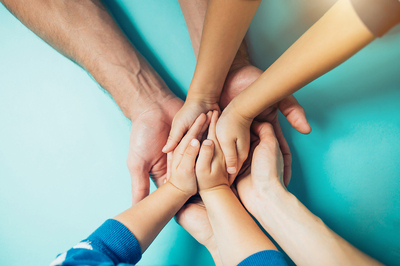 Group of people holding hands.