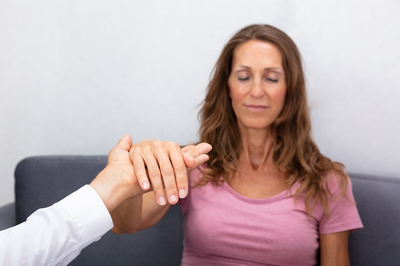 Woman participating in hypnotherapy.