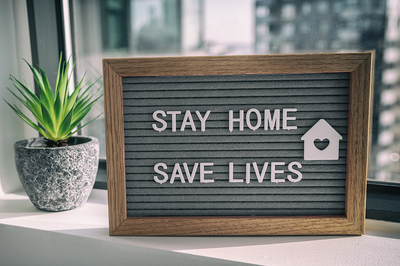 Stay home and save lives sign.