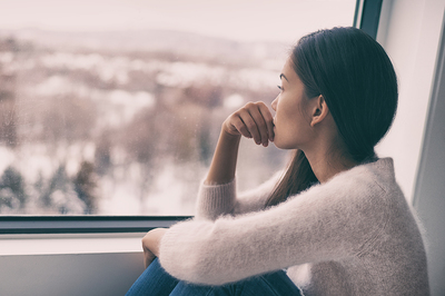 Looking out a window.
