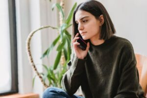Woman on the phone with a St. Louis alcohol treatment center