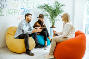 Two people sitting with a therapist