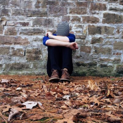 Sad person who would benefit from care at drug rehab clinics