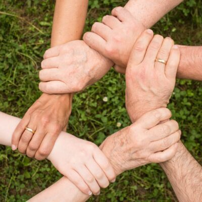 A family linking hands, showing their support after attending rehabs in Missouri